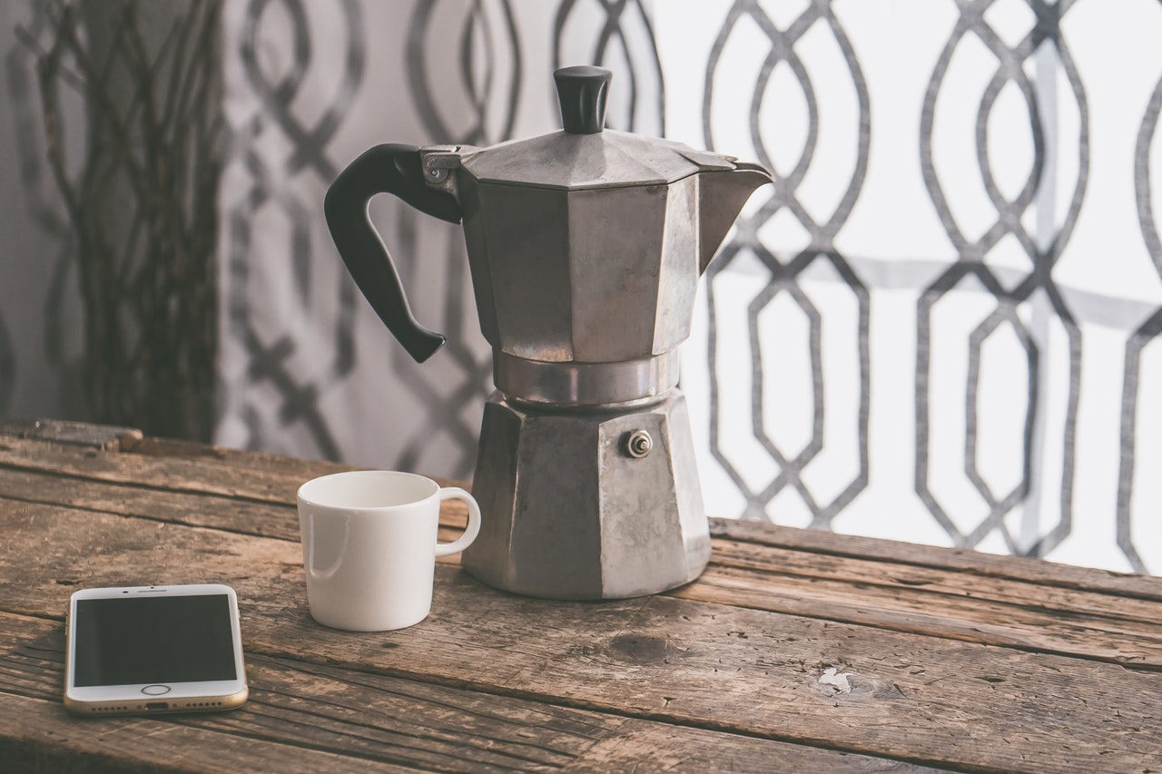 coffee percolator and a mobile phone