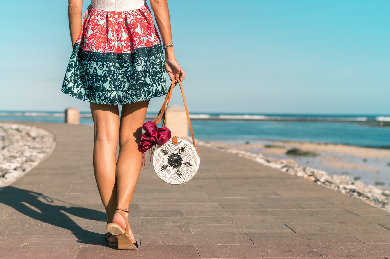 woman dressed with printed skirt